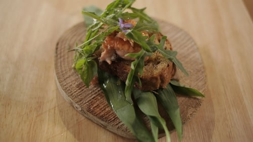 Martin Shanahan's Grilled Sea Trout served on Artisan Bread on a Bed of Wild Mixed Leaves