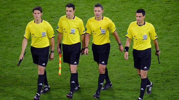 UEFA have no plans to dispense with the use of assistant referees for the time being