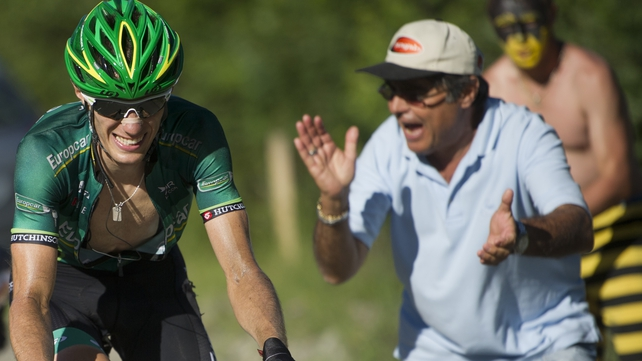 Stage winner Pierre Rolland is cheered on by a fan