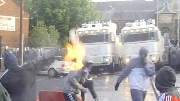 Petrol bombs have been thrown at riot police