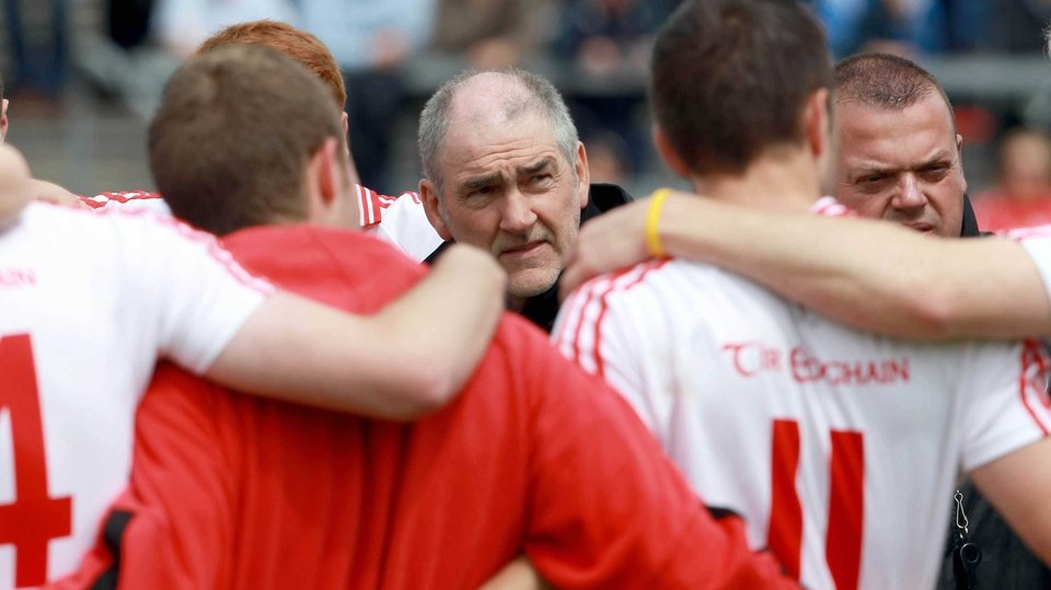 Tyrone manager Mickey Harte has a few words of encouragement for his charges before throw-in at Dr Hyde Park