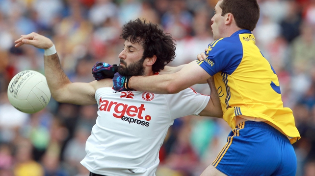 Jonathan Lafferty of Tyrone tries to escape the attentions of Roscommon's Niall Carty