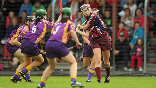 Aislinn Connolly gets her strike away under pressure from three Wexford players