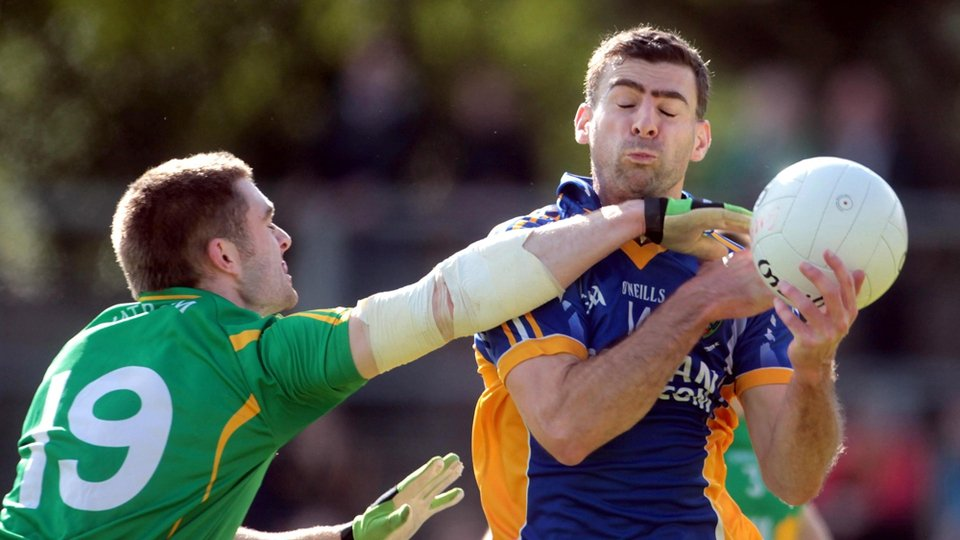 Tony Hannon of Wicklow is tackled by Leitrim's Alan Wynne