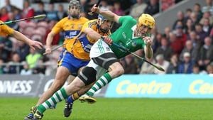 Clare's Brendan Bugler gets to grips with David Breen of Limerick