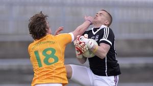 Antrim's Owen Gallagher challenges Galway goalkeeper Adrian Faherty