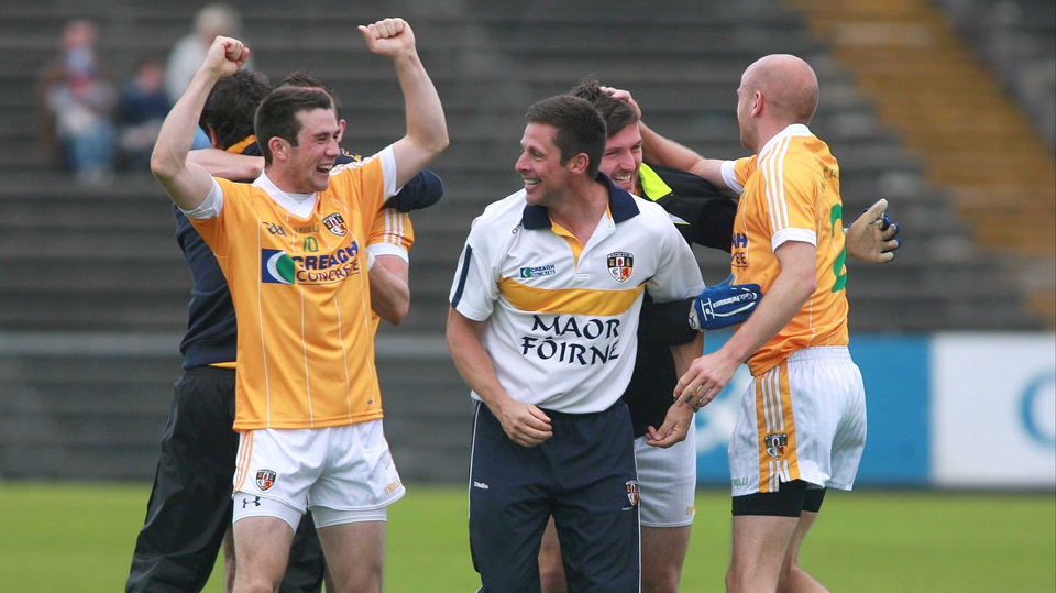 Antrim players celebrate at the final whistle