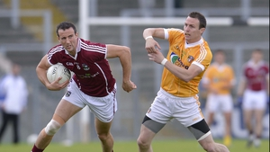 Antrim's Michael McCann chases Joe Bergin of Galway