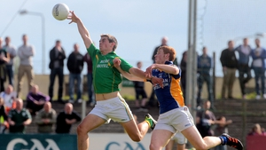 Leitrim's Shane Moran gets to a ball before Peadar Burke of Wicklow