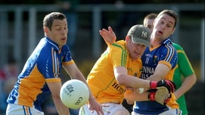 Leitrim goalkeeper Cathal McCrann is sandwiched by John McGrath (l) and Seanie Furlong of Wicklow