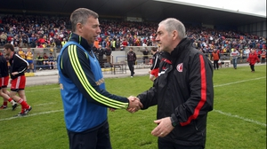 Roscommon Des Newton shakes hands with his Tyrone counterpart after the game