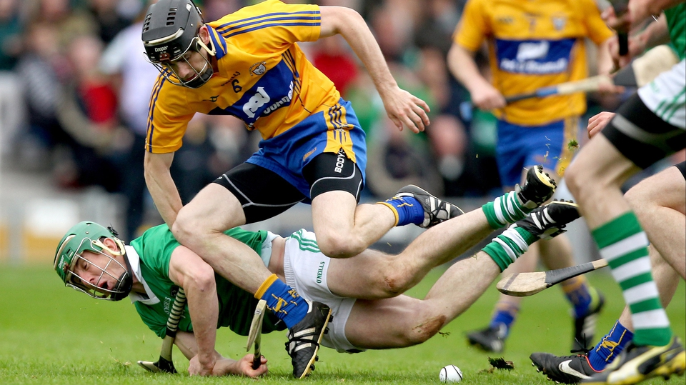 Limerick's Niall Moran loses his footing under pressure from Patrick Donnellan of Clare