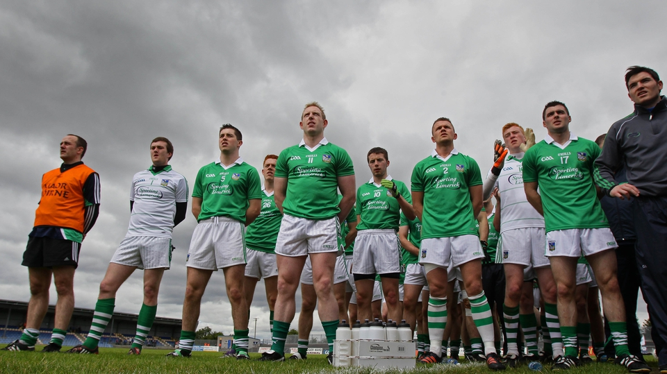 The Limerick footballers stand to attention for the national anthem at Pearse Park in Longford