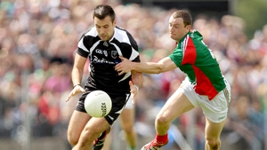 Mayo defender Keith Higgins is wrong-footed by Alan Costello of Sligo