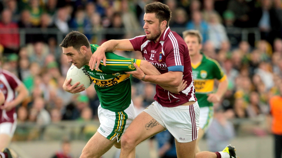 Westmeath's Paul Sharry pulls back Declan O'Sullivan of Kerry