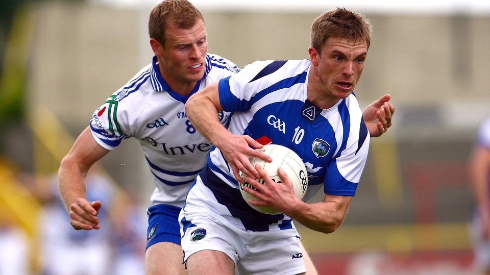 Ross Munnelly of Laois is hassled by Monaghan's Eoin Lennon