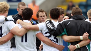 Seanie Johnston's head is just visible in the Kildare team huddle