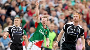 Sligo's Johnny Martin and Ross Donovan look on as Mayo's Colm Boyle celebrates a late score