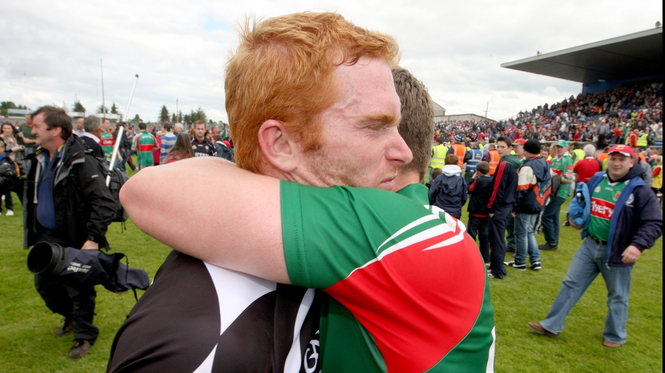 Mayo captain Andy Moran (r) consoles his Sligo counterpart Ross Donovan