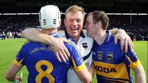 Tipperary manager Declan Ryan (centre) with Brendan Maher (l) and Lar Corbett (r) after the game