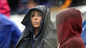 A Tipperary supporter tries to stay dry at Páirc Uí Chaoimh