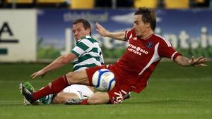 Pat Sullivan of Shamrock Rovers clashes with Aurimas Kucys of FK Ekranas
