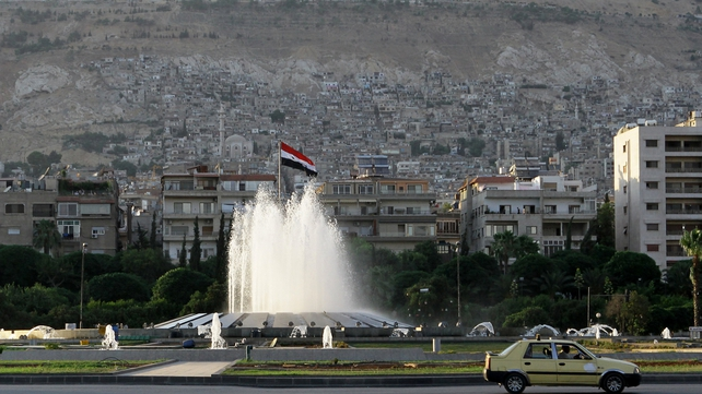 Syrian forces appear to have evacuated most personnel from army and security command headquarters in Damascus