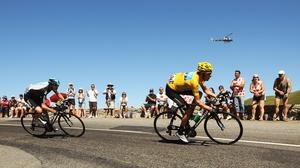 Bradley Wiggins has held onto the yellow jersey