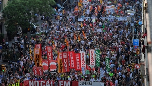 People protest during a demonstration organized by unions in Barcelona