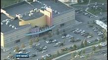 Man arrested after 12 shot dead at Denver cinema