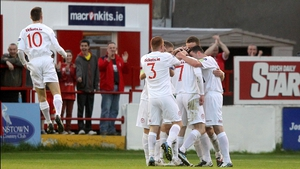 Shelbourne's players celebrate their equaliser at Tolka Park