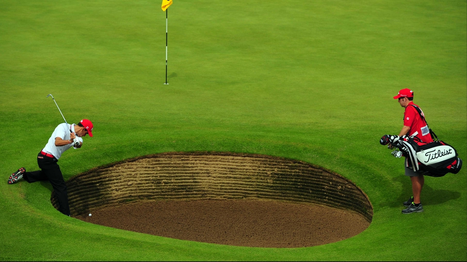 Rafael Cabrera-Bello gets creative with one of many bunkers dotted throughout The Open venue