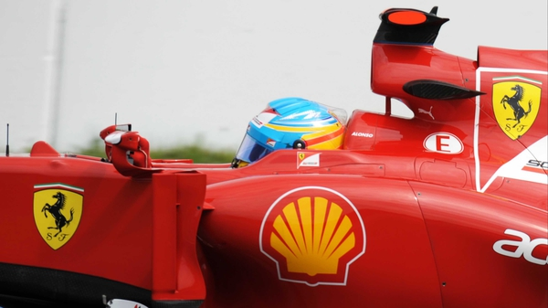 Fernando Alonso coped best with the wet conditions to take pole in the German Grand Prix