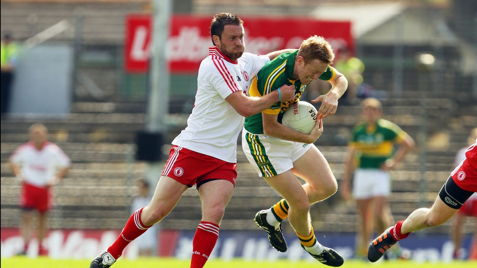 Tyrone's Martin Penrose tried to get to grips with Colm 'Gooch' Cooper