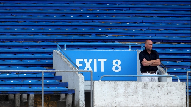 A lone spectator looks on from the stands during the game