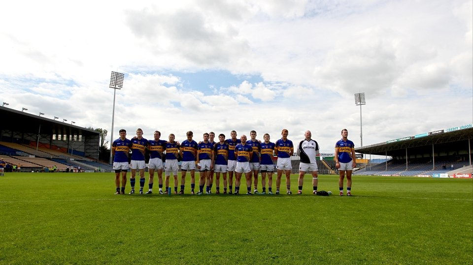 The Tipperary footballers stand to attention for the national anthem at Semple Stadium