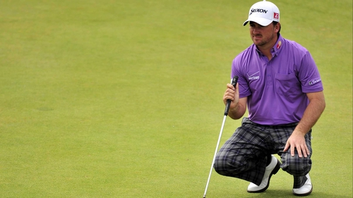 Graeme McDowell has raced into second place and will be playing in the final group on Sunday
