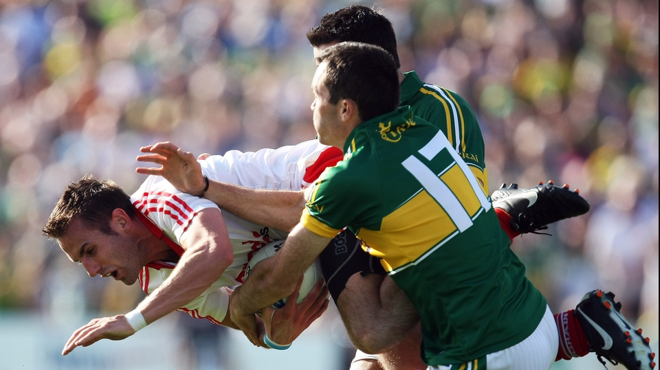 Kerry's Brian Maguire and Aidan O'Mahony put Mark Donnelly of Tyrone under pressure