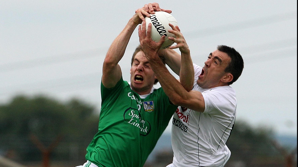 Kildare's Johnny Doyle (r) and Seanie Buckley of Limerick compete for an aerial ball