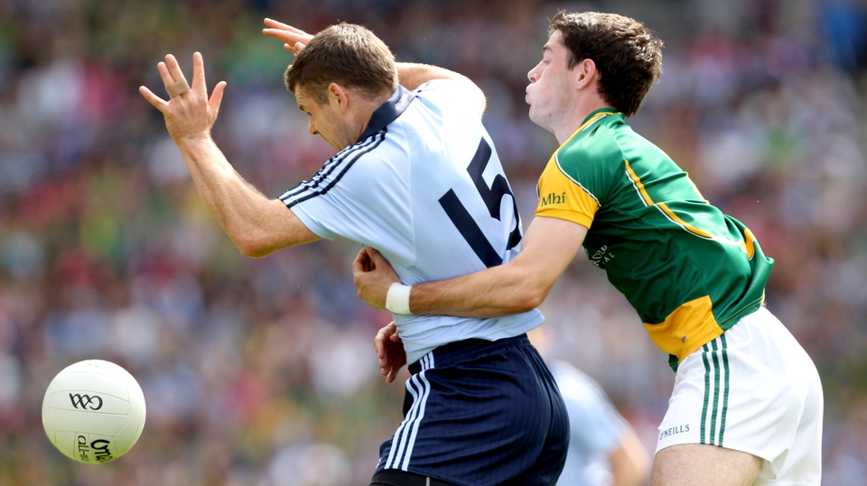 Dublin's Kevin McManamon is closely marked by Donal Keogan