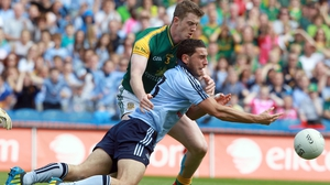 Bernard Brogan is challenged by Kevin Reilly of Meath
