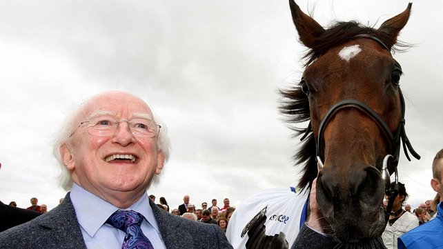 President Michael D Higgins and Oaks winner Great Heavens pose for the cameras