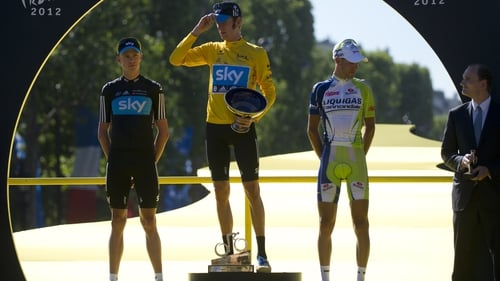 Second-placed Christopher Froome, winner Bradley Wiggins, and third-placed Vincenzo Nibali