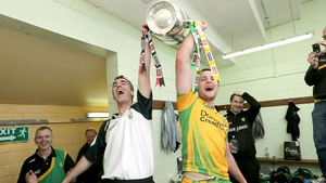 Jim McGuinness and Michael Murphy hoist the trophy