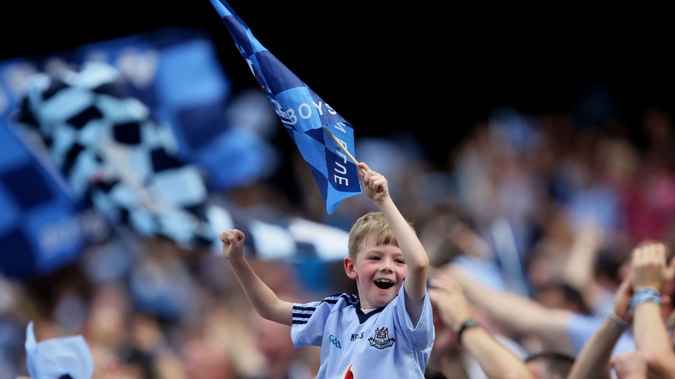 A young Dublin fan celebrates a score for the Metropolitans