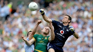 Dublin goalkeeper Stephen Cluxton and Rory O'Carrroll contest a high ball with Joe Sheridan of Meath