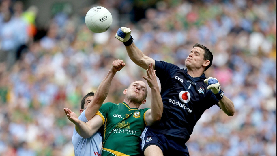 Dublin goalkeeper Stephen Cluxton and Rory O'Carrroll contest a high ball with Joe Sheridan of Meath