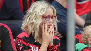 A Down fan takes in her side's loss