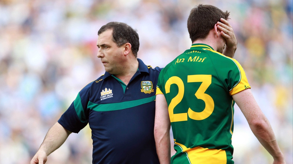 Meath manager Seamus McEnaney consoles a dejected Peadar Byrne at the end of the game