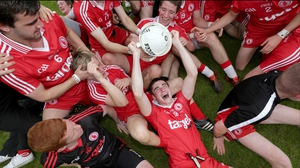 Tyrone's minor captain Michael Cassidy celebrates with team-mates after their 0-14 to 1-08 victory